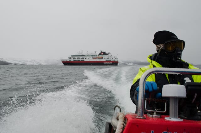Speeding away from Hurtigruten's FRAM this morning on our way to Telefon Bay. Photo © 2015 Aaron Saunders